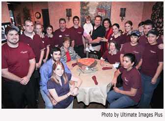 Ann Collier with her family and staff - J. Christopher's Pizza Pasta Family Restaurant.